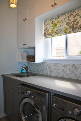 two tone laundry room cabinetry